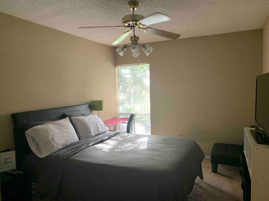 Your bedroom with natural light, complete with a desk, TV and AppleTV/Netflix