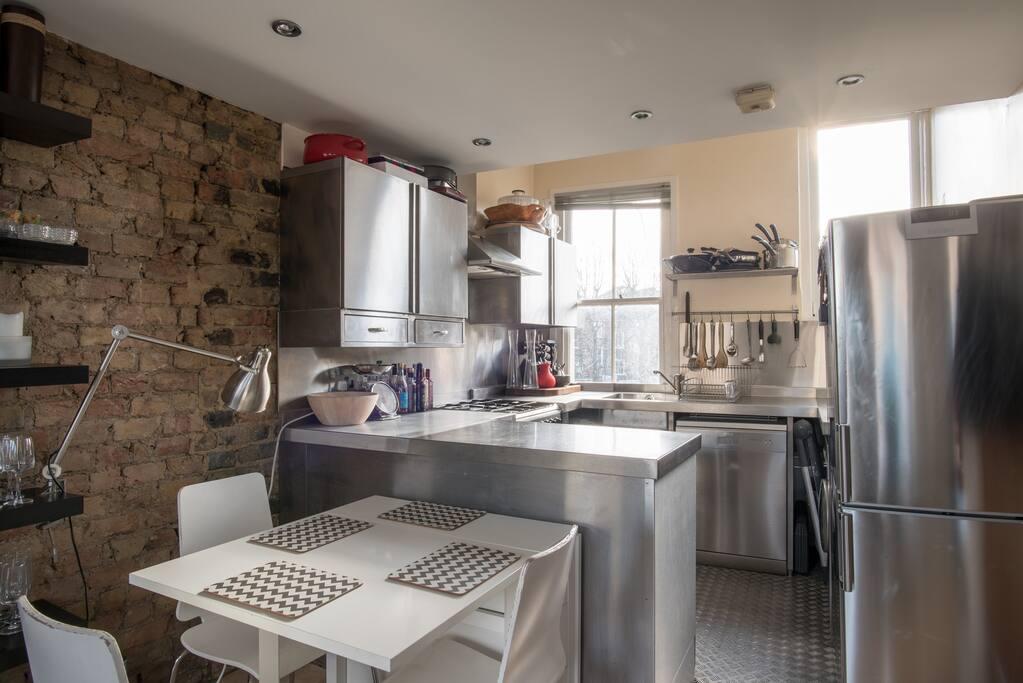 The kitchen has gas hob, electric oven, dishwasher, washing machine, Nespresso machine and microwave.