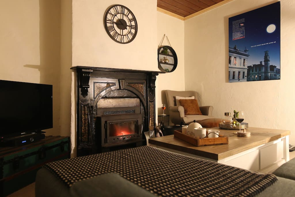 Lounge with cosy fireplace