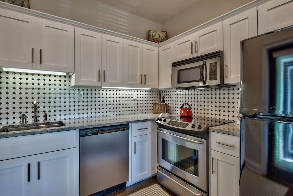 You'll find stainless steel appliances contrast perfectly with the creative backsplash.