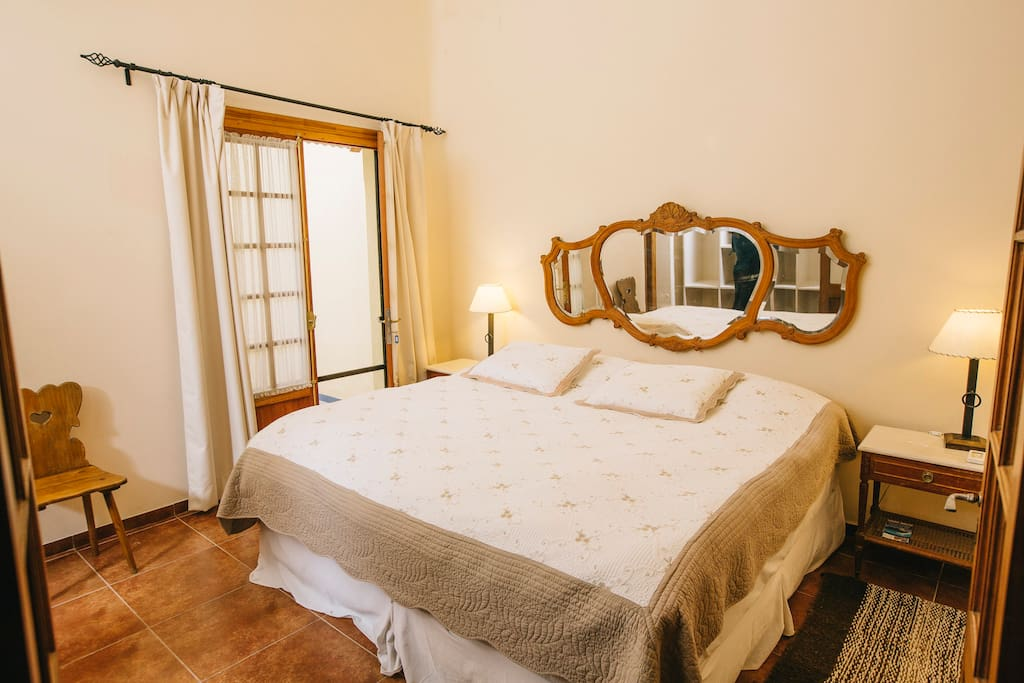 Well furnished double bedrooms with antique furniture