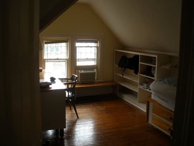 Third floor bedroom with built in single bed, huge desk, cupboards and shelves; under the eaves; a fun room