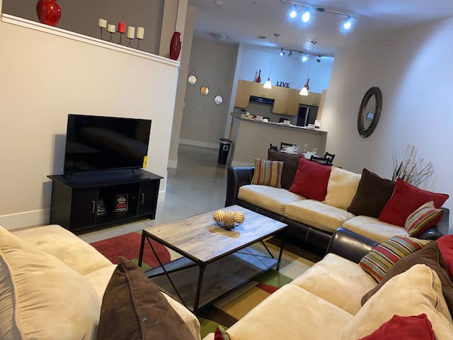 Spacious living room with two full size couches and love seat