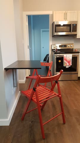 Small kitchen table that folds down to save space.