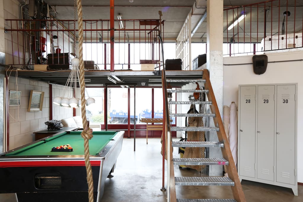 pooltable area with stairs to entresol and climbing rope