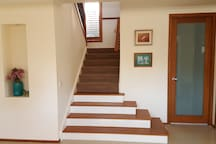 STAIRCASE TO FIRST LEVEL. NOTE THE LANDING HALFWAY FOR EASE OF GUEST CLIMB