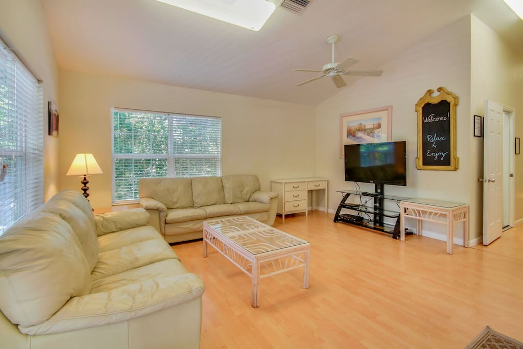 """The living area has a plush microfiber sofa, love seat, and recliner, plus a 54"""" flat-screen with DVD player."""