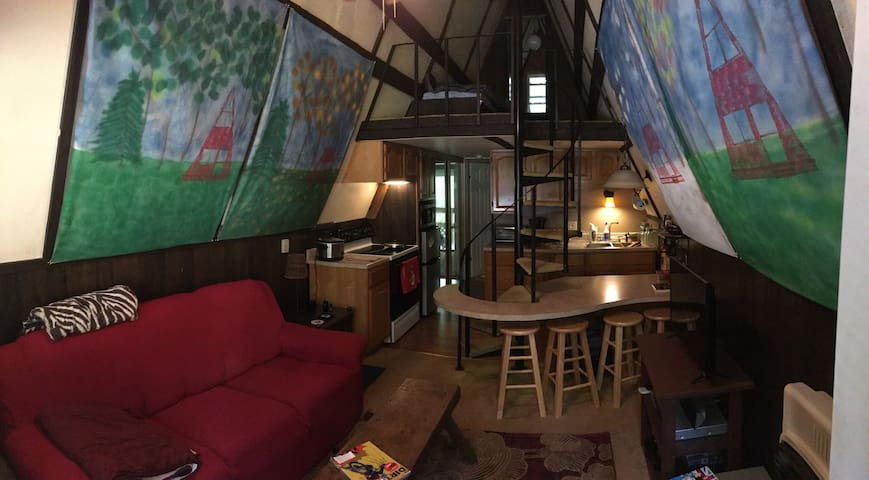 Living space, kitchen, loft up top.