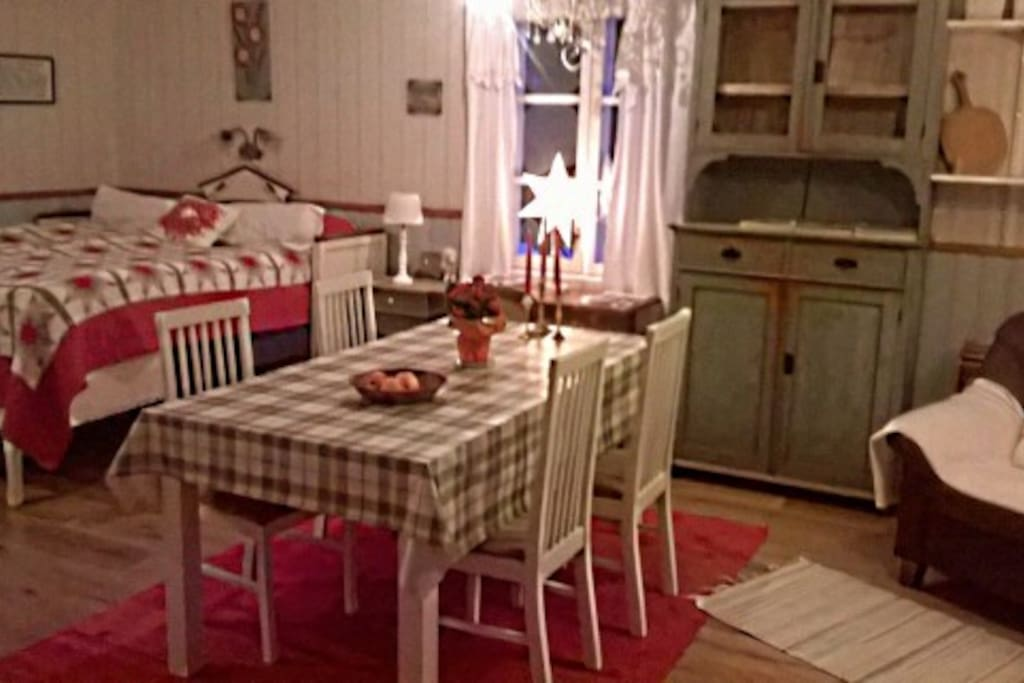 The the dinner table with a little bit of the armchair
