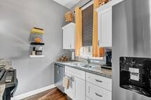 Kitchen: Full-size dishwasher and refrigerator with ice-maker/water dispenser