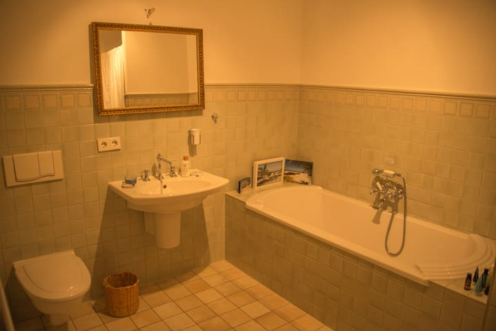 The second bathroom includes a large bathtub and a shower
