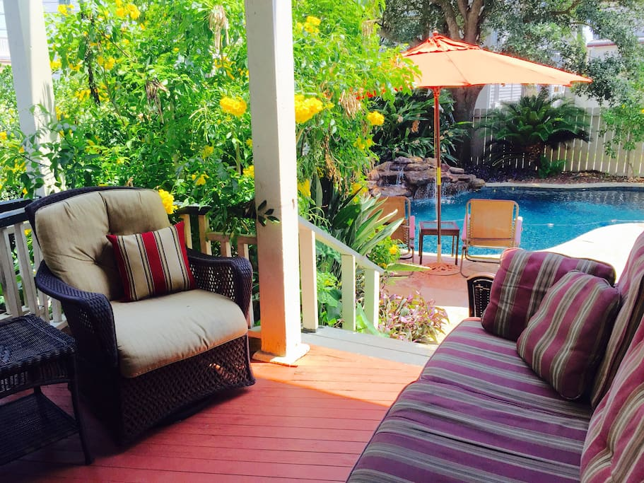 Lounge on the porch or by the pool.