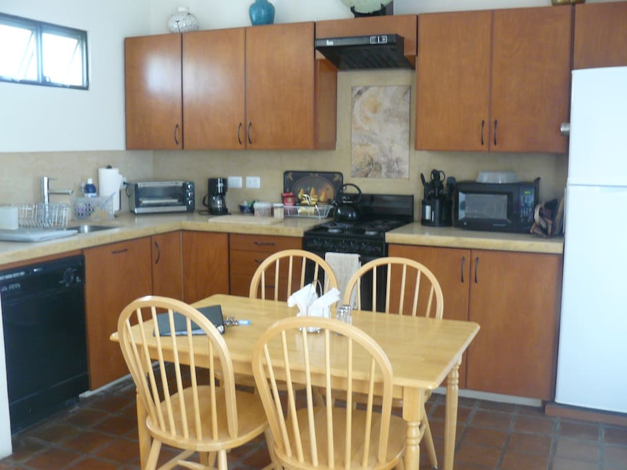 Fully equipped kitchen and dining area.