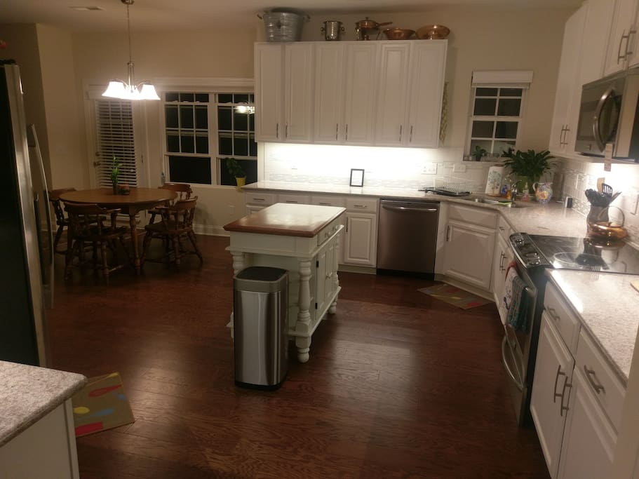Large, spacious kitchen opens up to breakfast area and living room