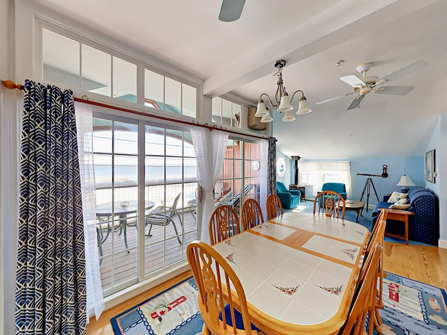 The sun-filled dining room offers lovely patio views and seating for up to 10.