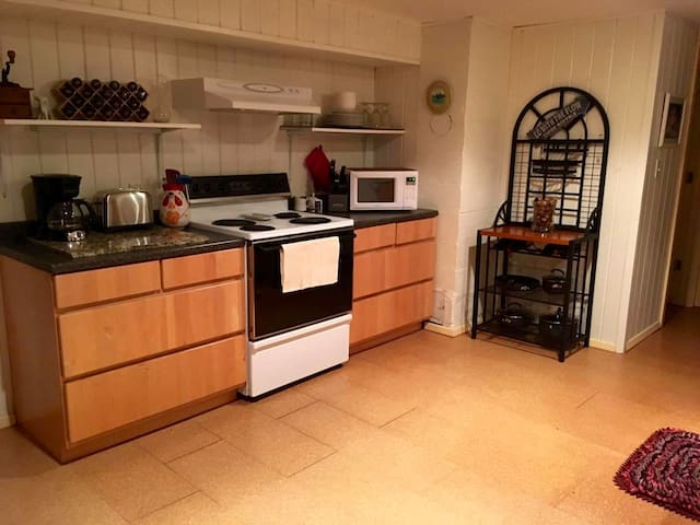 Full kitchen for your culinary needs.  Stocked with pots, pans, dishes, silverware, coffee maker/filters, microwave and full size refrigerator.