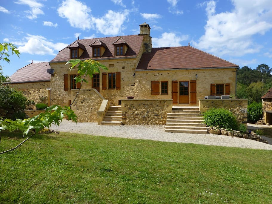 Gorgeous stone farmhouse with raised terrace overlooking the swimming pool