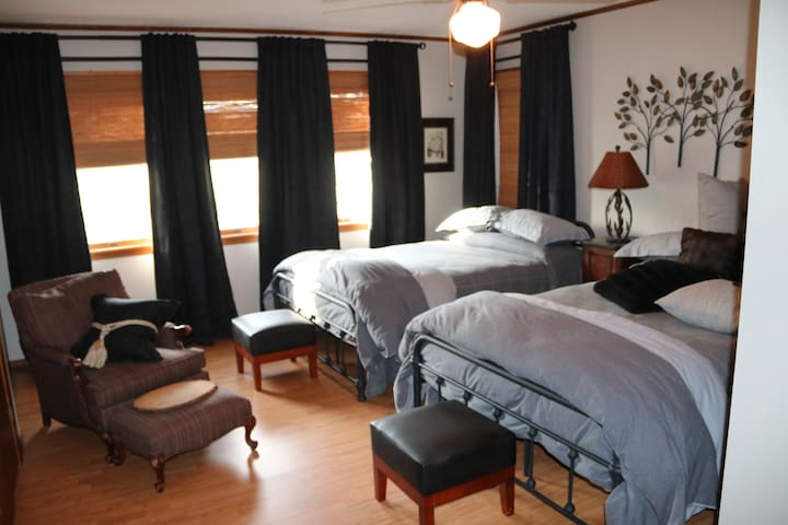 2nd Bedroom contains two double beds and has a bathroom in the room. Holds 4 comfortably.