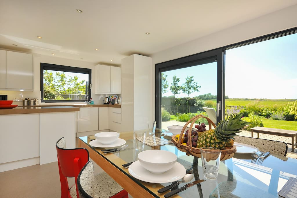 Stunning open plan kitchen dining on to the deck and beyond!