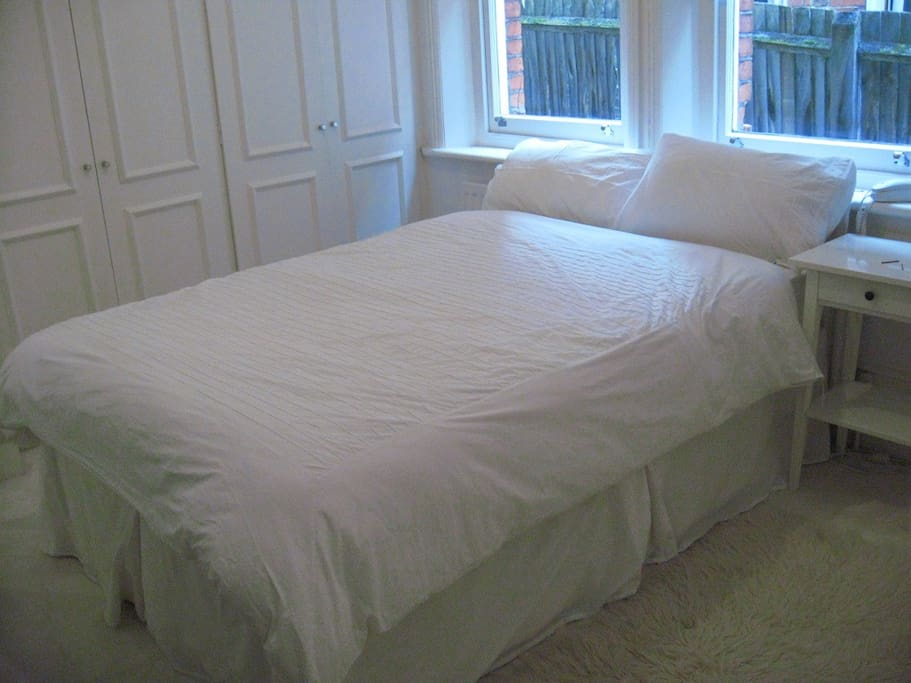 comfortable double bed with spacious wardrobes