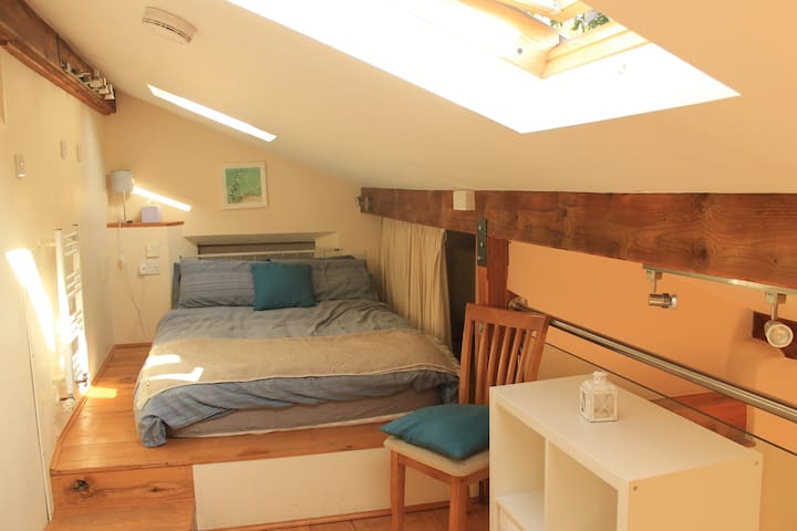 The Hide's cosy mezzanine sleeping area with double bed