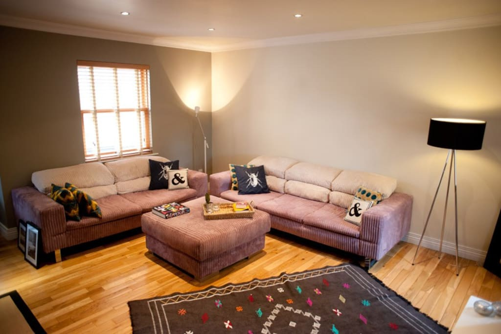 Comfortable living room with with plenty of room to lounge, relax, watch TV or sit by the fire.