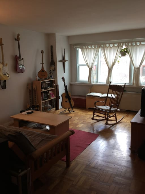 this is the living room area.  great light. we will remove the guitars so you don't have to worry about them!
