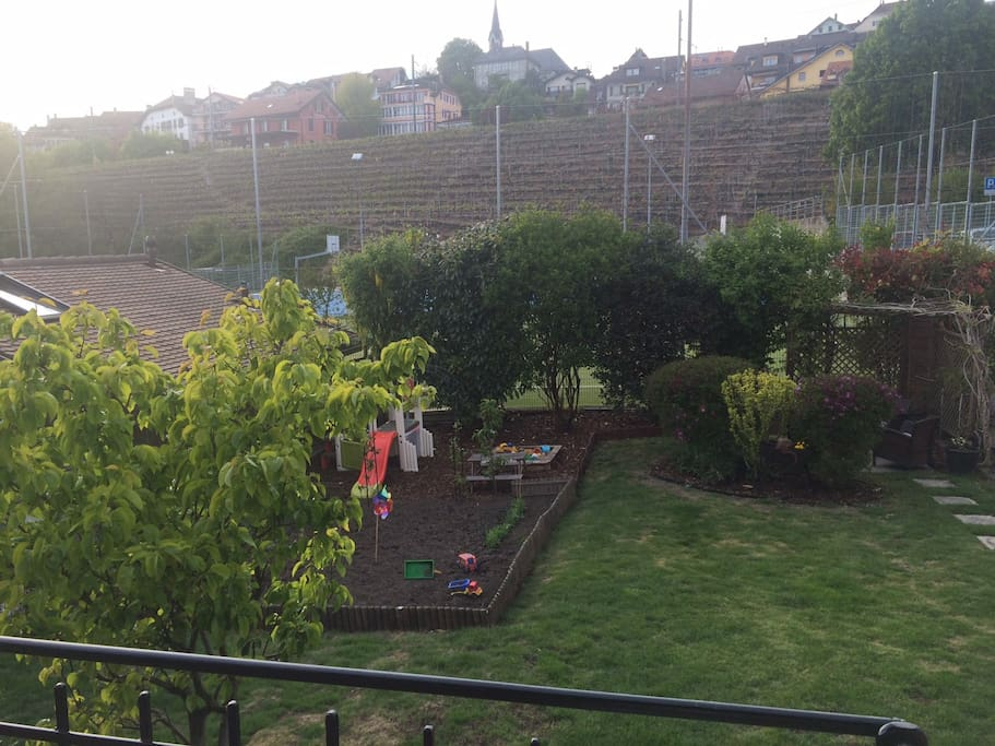 Our fenced in garden with toys for children, BBQ and outdoor seating