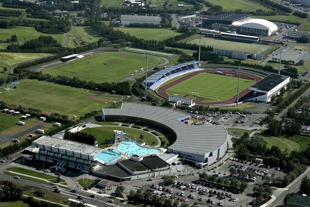 Laugardalslaug public pool, World Class gym&spa and Laugardalsvöllur football field.