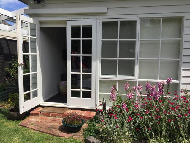 Master bedroom opens onto back garden