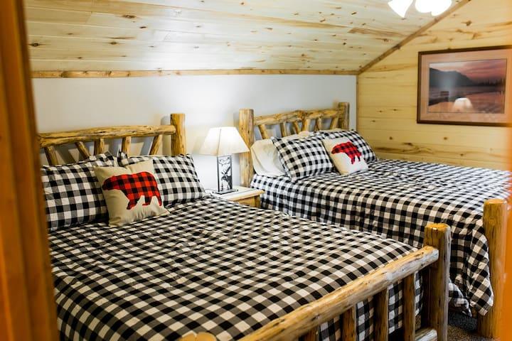 Upstairs bedroom- two queen beds