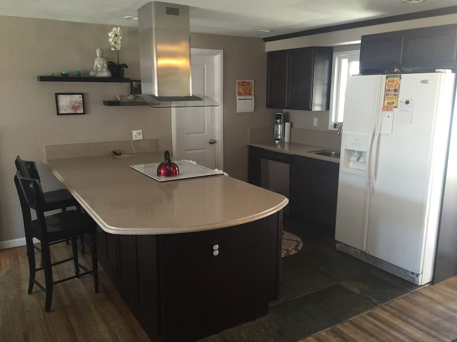 Updated kitchen with Quartz countertop and breakfast bar.