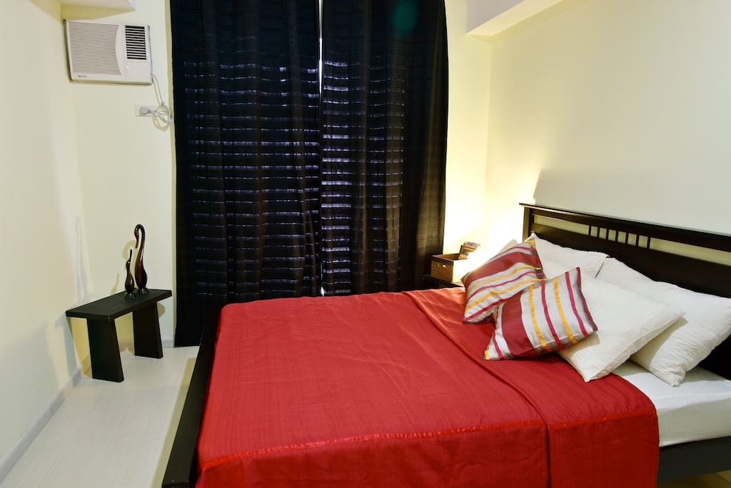 Bedroom- white curtain available for a brighter room! Opens up the Pasig River view and partial Rockwell Center Skyline
