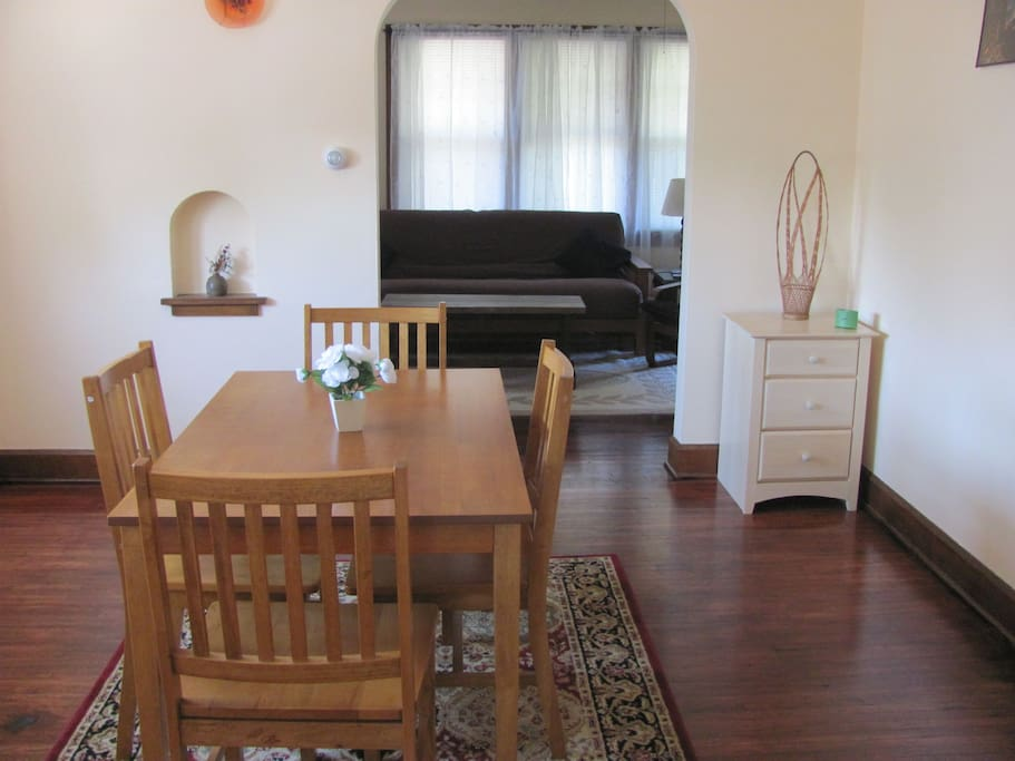 With a bright dining room, and plenty of hardwood floors
