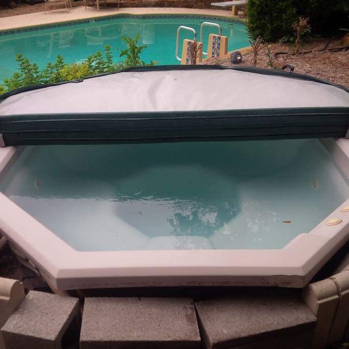 Open Air amazing 8 person Hot Tub piping hot all year round overlooking the Pool and Flower garden in Backyard Paradise.