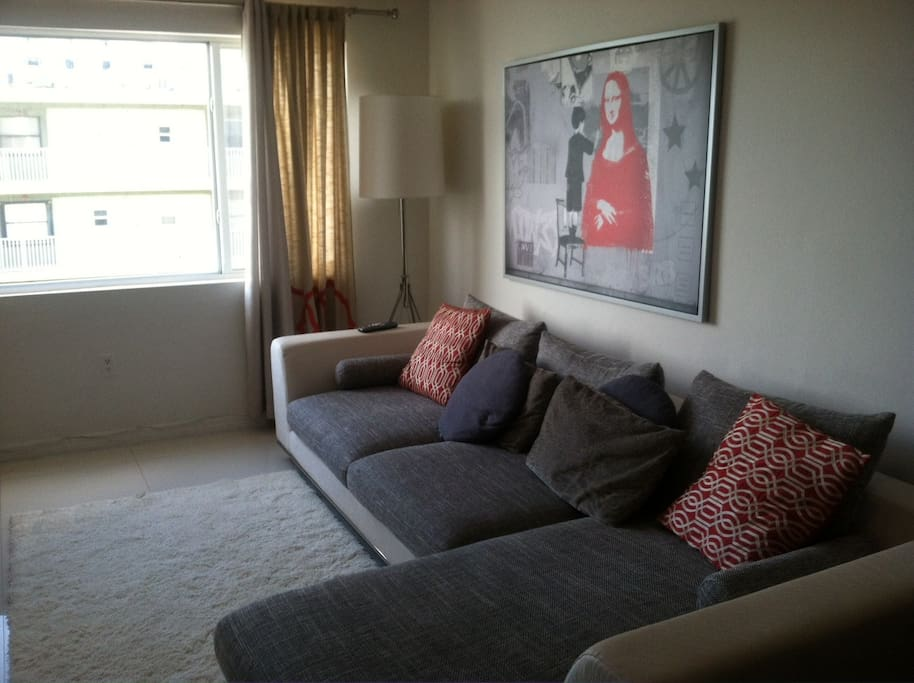 Living room with large modern sofa