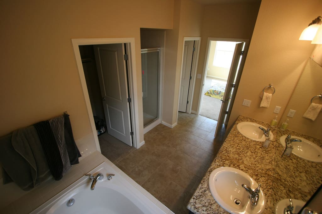 This is the master bath off the master suite.  His and hers sinks, bath, shower, and separate toilet.