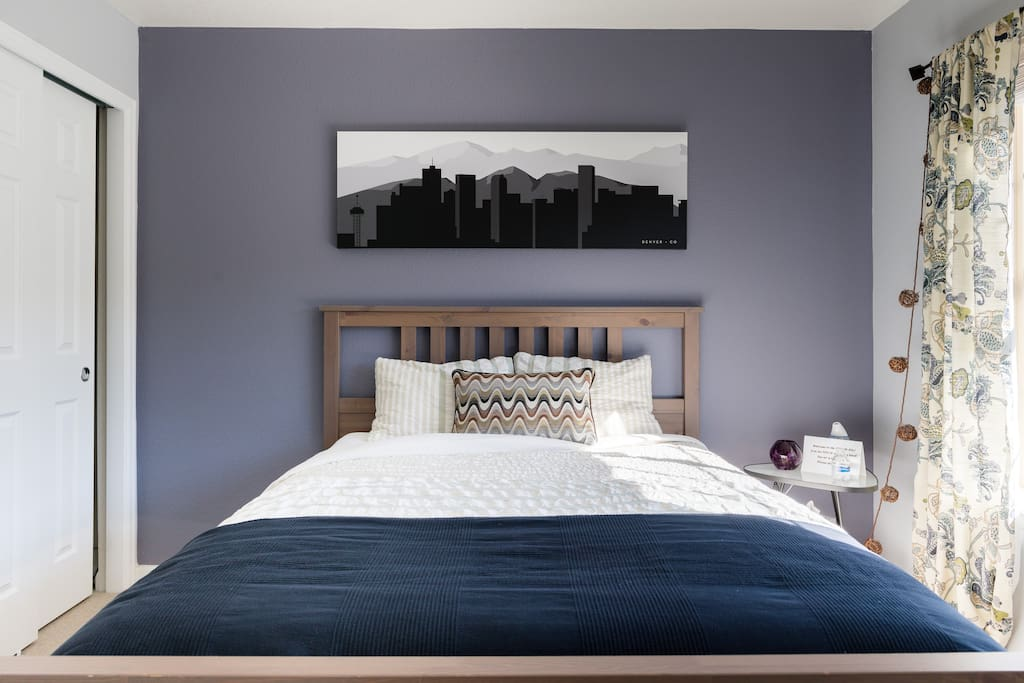Queen-size bed with extra pillows and blankets available. It is a European style bedding layer with Duvet cover and fitted sheet.