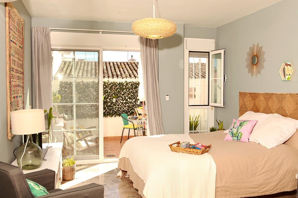 Lovely bedroom area open to the sunny and bright patio