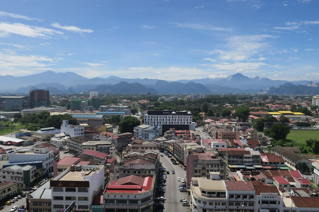 Breathtaking view of the majestic Titiwangsa Mountain Range surrounding the historic Kinta Valley as seen from the unit