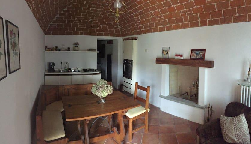 Cucina e Salotto con camino