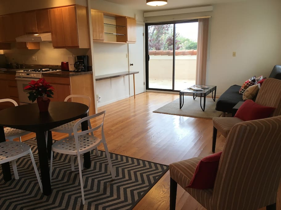 Spacious open plan living/dining room and kitchen opening on to private patio