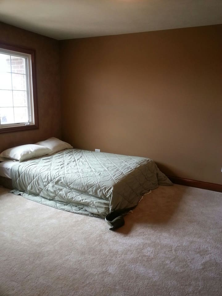 This is an old picture. Now there are some furniture in the bedroom.