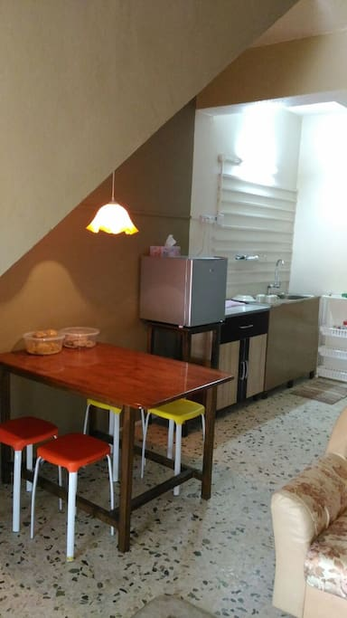 dining area with washing sink, mini fridge and working counter