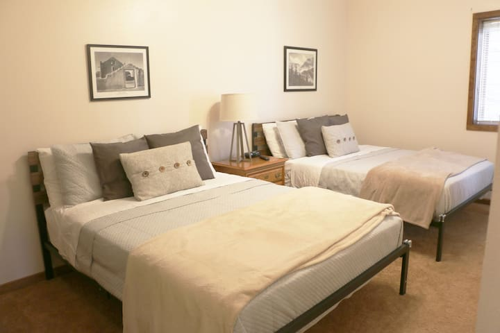 1st ground floor bedroom with two queen beds and a Smart TV for streaming.