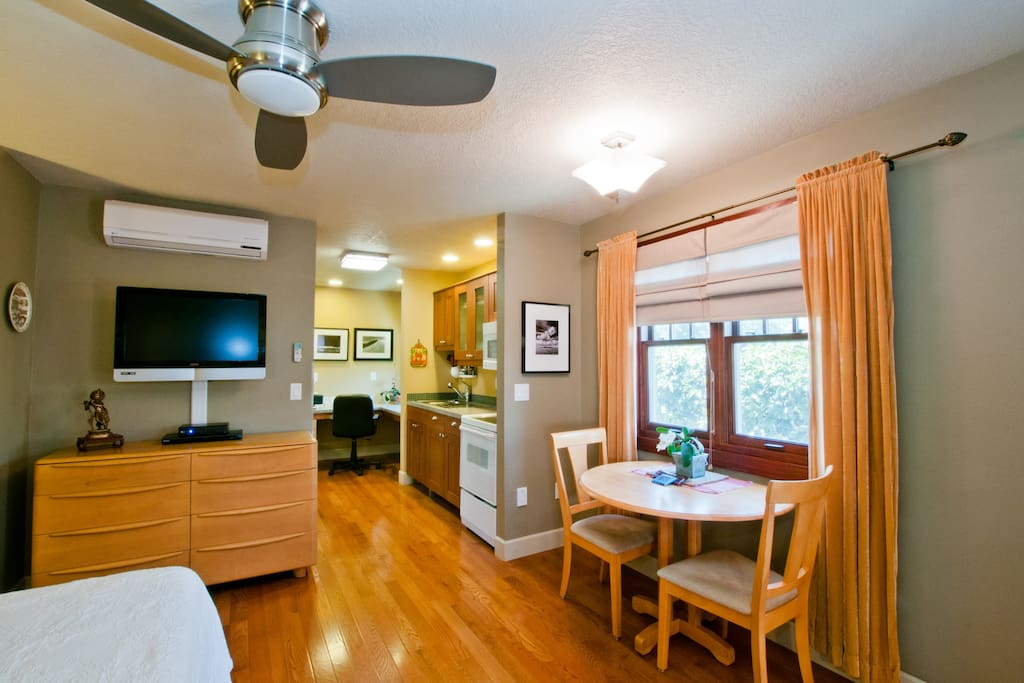 Efficient use of space has a dining table and full kitchen.