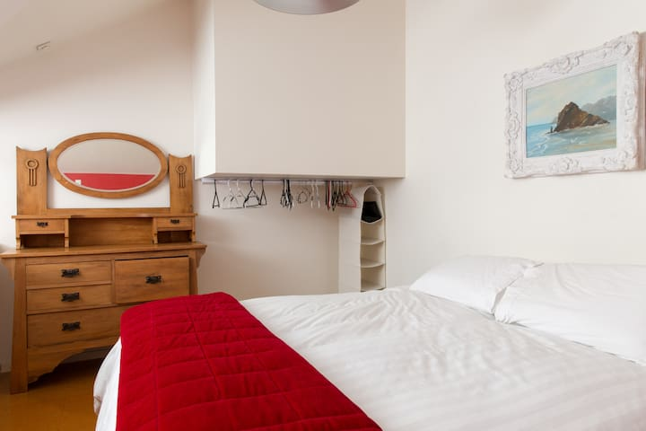 Mezzanine bedroom upstairs open to lounge with air conditioning unit for summer nights. King size bed, feather duvet