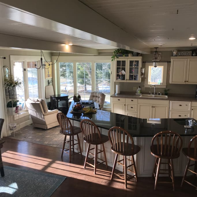 Spacious kitchen with 5 seats at granite island, large dining table that seats 8. French doors to covered porches. Gas stove, refrigerator, dishwasher, microwave and coffee maker. All standard dishes, utensils and cookware also.