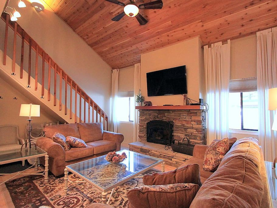 Wood fireplace and flat screen TV