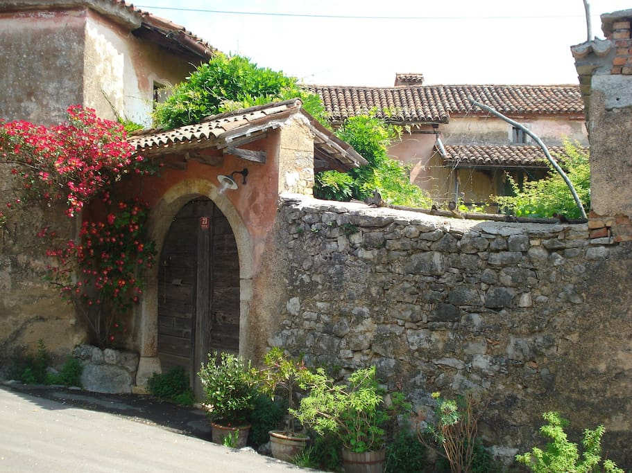 Behind this entrance there is beautiful, cosy courtyard/garden